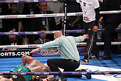 24th March 2018, O2 Arena, London, England; Matchroom Boxing, WBC Silver Heavyweight Title, Dillian Whyte versus Lucas Browne; Referee Ian John Lewis immediately waives off the fight as Lucas Browne is knocked out from a thunderous shot from Dillian Whyte