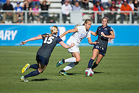 Cary, North Carolina - Sunday December 6, 2015: Rebecca Quinn (5) of the Duke Blue Devils dribbles the ball between Haleigh Echard (15) and Frannie Crouse (9) of the Penn State Nittany Lions during first half action at the 2015 NCAA Women's College Cup at WakeMed Soccer Park.  The Nittany Lions defeated the Blue Devils 1-0.