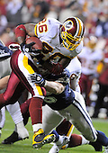 Landover, MD - November 16, 2008 -- Dallas Cowboys visit the Washington Redskins running back Clinton Portis (26) carries in first quarter action against the Dallas Cowboys at FedEx Field in Landover, Maryland on Sunday, November 16, 2008.  Portis ended the evening with 68 yards on 15 carries.  The Redskins lost the game 14 - 10..Credit: Ron Sachs / CNP
