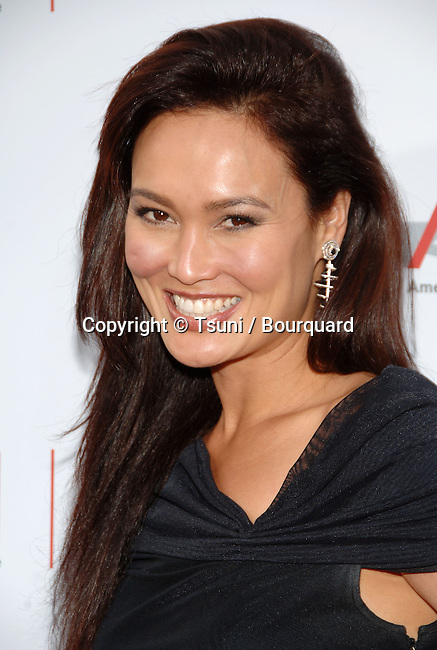 Tia Carrere arriving at the AFI Honoring Sean Connery At The Kodak Theatre in Los Angeles. June, 8, 2006.