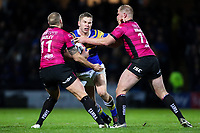 Picture by Alex Whitehead/SWpix.com - 08/03/2018 - Rugby League - Betfred Super League - Leeds Rhinos v Hull FC - Emerald Headingley Stadium, Leeds, England - Leeds' Matt Parcell is tackled by Hull FC's Dean Hadley and Danny Washbrook.