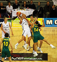 Tall Ferns' Natalie Purcell beats Rohanee Cox to the ball during the International women's basketball match between NZ Tall Ferns and Australian Opals at Te Rauparaha Stadium, Porirua, Wellington, New Zealand on Monday 31 August 2009. Photo: Dave Lintott / lintottphoto.co.nz