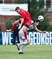 Andy Riemer (20) of Georgetown goes up for a header with Jack Bennett (11) of St. John's during the game at North Kehoe Field in Washington DC. Georgetown defeated St. John's, 2-1, in the Big East conference tournament quarterfinals.