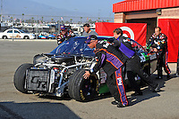 Oct. 11, 2009; Fontana, CA, USA; The car of NASCAR Sprint Cup Series driver Denny Hamlin is pushed towards the hauler in the garage after crashing during the Pepsi 500 at Auto Club Speedway. Mandatory Credit: Mark J. Rebilas-