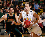 JANUARY 30, 2015 -- Dylan King #21 of Regis University drives past Nick Ongarato #2 of Black Hills State during their Rocky Mountain Athletic Conference men's basketball game Friday evening at the Donald E. Young Center in Spearfish, S.D.  (Photo by Dick Carlson/Inertia)
