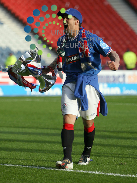 Nacho Novo with the cup during The Co-Operative League Cup Final 2009/10 between St Mirren and Rangers at The National Stadium Hampden Park Glasgow 21/03/10..Picture by Ricky Rae/universal News & Sport (Scotland).