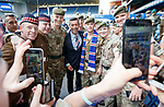 Pedro Caixinha with members of the armed forces before the match at Ibrox