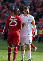 20 April 2013: Toronto FC defender Jeremy Hall #25 talks with Houston Dynamo forward Will Bruin #12 during an MLS game between the Houston Dynamo and Toronto FC at BMO Field in Toronto, Ontario Canada..The game ended in a 1-1 draw...