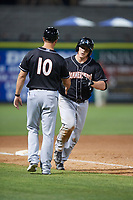 Jupiter Hammerheads first baseman Skyler Ewing (44) is congratulated by manager Kevin Randel (10) as he rounds third base after hitting a ninth inning home run during a game against the Clearwater Threshers on April 9, 2018 at Spectrum Field in Clearwater, Florida.  Jupiter defeated Clearwater 9-4.  (Mike Janes/Four Seam Images)