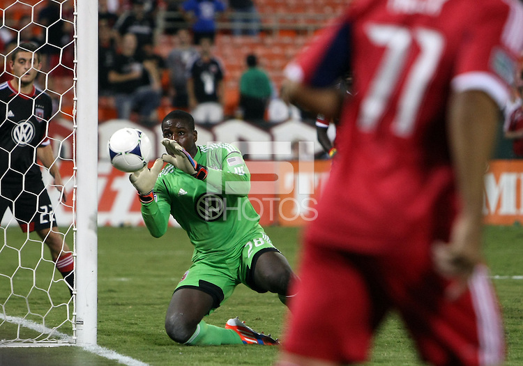 WASHINGTON, DC. - AUGUST 22, 2012:  Bill Hamid (28) of DC United stops a shot by Alex (71) of the Chicago Fire during an MLS match at RFK Stadium, in Washington DC,  on August 22. United won 4-2.