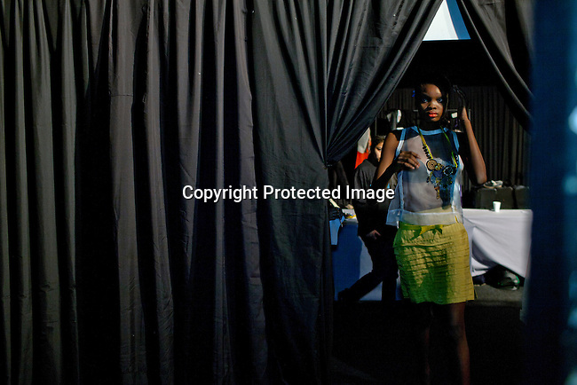 CAPE TOWN, SOUTH AFRICA AUGUST 9: Favour Lucky, a 15-year old Nigerian model, runts backstage during a fashion show on August 9, 2013 in Cape Town, South Africa. She won Nigeria's next supermodel and has worked at fashion weeks in Johannesburg, Cape Town, New York and others. She walked in several shows at Mercedes Benz Cape Town Fashion Week where some of South Africa's finest designers showed their 2012-13 spring and summer collections during the 4-day event (Photo by: Per-Anders Pettersson)