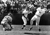 St. Louis Cardinal catcher Darrell Porter is late to tag <br />