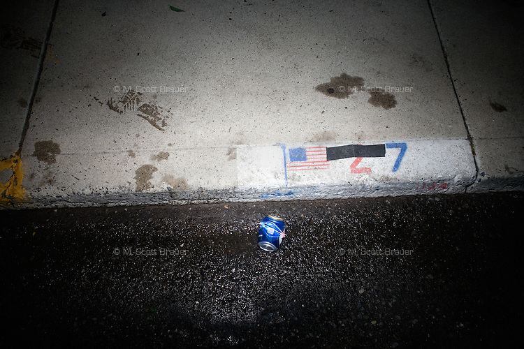 Garbage on the ground at night at Evel Knievel Days in Butte, MT, USA.
