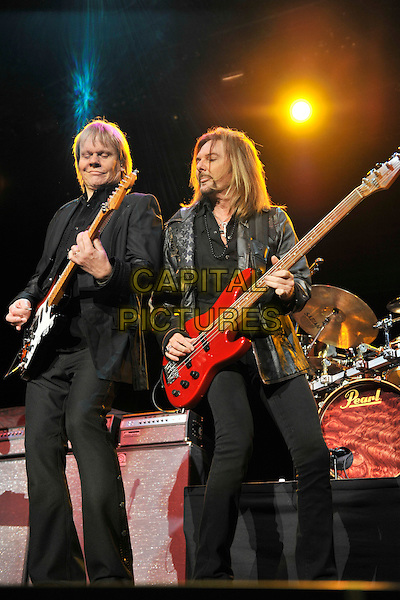 Styx - James Young & Ricky Phillips.Styx performing live at Wembley Arena, London, England..June 4th, 2011.stage concert live gig performance music full length black  suit guitar.CAP/MAR.© Martin Harris/Capital Pictures.