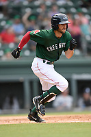 Left fielder Jagger Rusconi (7) of the Greenville Drive runs out a batted ball in a game against the Asheville Tourists on Sunday, June 3, 2018, at Fluor Field at the West End in Greenville, South Carolina. Greenville won, 7-6. (Tom Priddy/Four Seam Images)