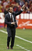 Head coach of Real Salt Lake Jason Kreis gestures during a game against D.C. United during the first half of the U.S. Open Cup Final on October  1, 2013 at Rio Tinto Stadium in Sandy, Utah.