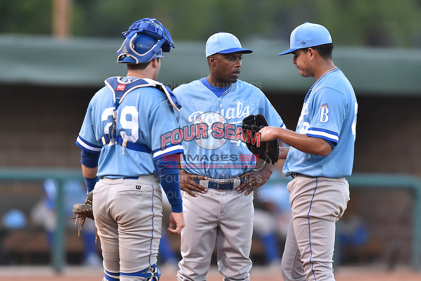 Burlington Royals catcher Chase Livingston (29),  pitching coach Carlos Martinez (40) talk with starting pitcher Cristian Castillo (43) during game against the Elizabethton Twins at Joe O'Brien Field on August 24, 2016 in Elizabethton, Tennessee. The Royals defeated the Twins 8-3. (Tony Farlow/Four Seam Images)