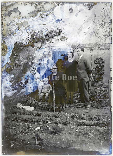 severely eroding glass plate with three generations family group portrait