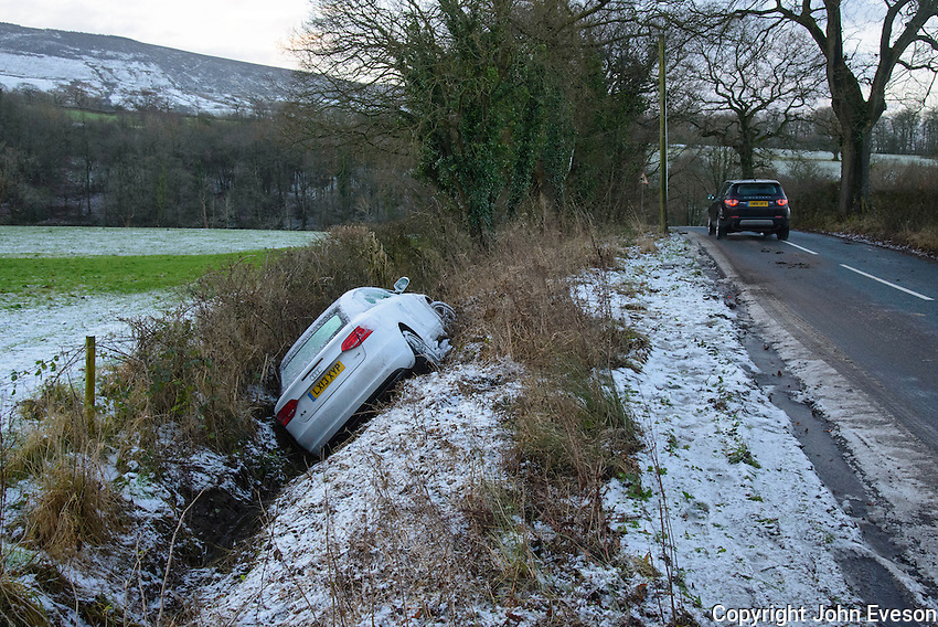 An Audi car slipped off an icy road and in a ditch, Whitewell, Lancashire.