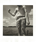 Brendan at Moosehead Lake, ME. making muscle. 1998. Vintage prints, Agfa Brovira 111, 98-085-G #2 file#