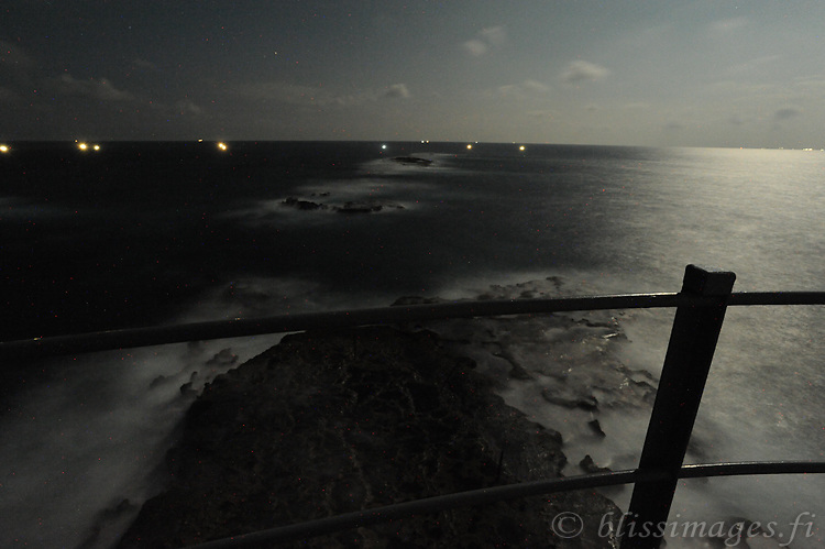 Great Basses Reef Lighthouse surrounded by night fishermen 8 miles offshore southwestern Sri Lanka.