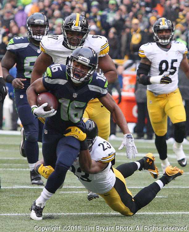 Seattle Seahawks kick off turn specialists Tyler Lockett is tackled by Pittsburgh Steelers safety Mike Mitchell (23) at CenturyLink Field in Seattle, Washington on November 29, 2015.  The Seahawks beat the Steelers 39-30.      ©2015. Jim Bryant Photo. All Rights Reserved.