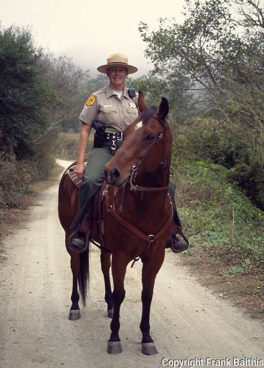 California State Park ranger on horse patrol at Burleigh Murray Ranch State Park