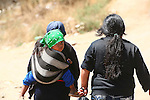 HUSBAND and WIFE WALK to MARKET WITH TODDLER in SLING OVER WIFE's SHOULDER. <br /> (1)