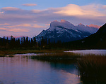 Banff National Park, AT: Evening light on Mount Rundle and gathering clouds from Vermillion Lake