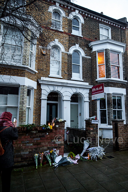 Brixton, 40 Stansfield Road. <br /> <br /> London, 11/01/2016. Today, David Bowie has died at the age of 69. During the day London's people gathered in Brixton (At Jimmy C graffiti, outside the house at 40 Stansfield Road where he was born, and for the street party outside the Ritzy Cinema) and outside 23 Heddon Street (Where a plaque commemorates Ziggy Stardust) to leave a flower, a message, an album, a candle, a letter; tokens to remember and commemorate a Londoner, an icon and a legend of the world music. David Bowie, real name David Robert Jones (8 January 1947 &ndash; 10 January 2016), was born in Brixton. He was an English singer, songwriter, multi-instrumentalist, record producer, arranger, painter and actor. He died 18 months after being diagnosed with cancer. On the 8th of January, day of his 69th birthday, David Bowie released his 27th and last album: &quot;Blackstar&quot;.<br /> <br /> For more information please click here: http://www.davidbowie.com/