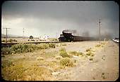 Train alongside highway south of Alamosa.<br /> D&amp;RGW