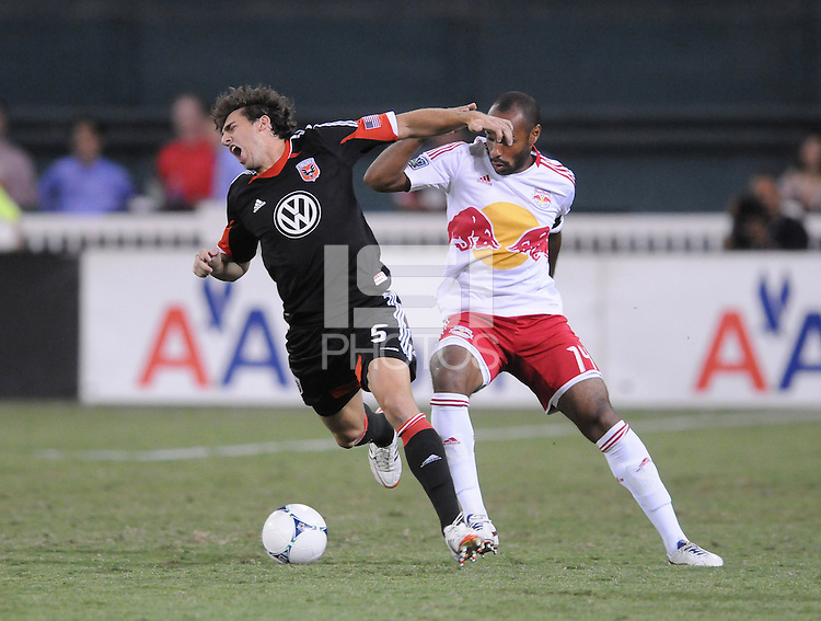 D.C. United defender Dejan Jakovic (5) gets fouled by New York Red Bulls forward Thierry Henry (14) The New York Red Bulls tied D.C. United 2-2 at RFK Stadium, Wednesday August 29, 2012.