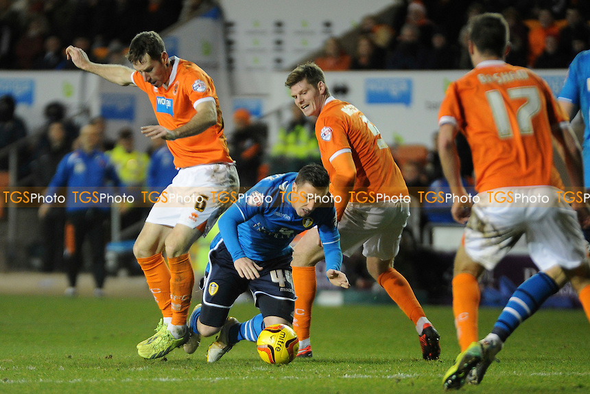 Kirk Broadfoot of Blackpool and Gary MacKenzie of Blackpool block Ross McCormack of Leeds United - Blackpool vs Leeds United - Sky Bet Championship Football at Bloomfield Road, Blackpool, Lancashire - 26/12/13 - MANDATORY CREDIT: Greig Bertram/TGSPHOTO - Self billing applies where appropriate - 0845 094 6026 - contact@tgsphoto.co.uk - NO UNPAID USE