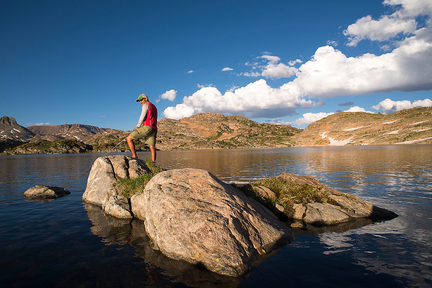 An angler cast for Yellowstone cutthroat trout at Lower Aero Lake in the Absaroka-Beartooth Wilderness.
