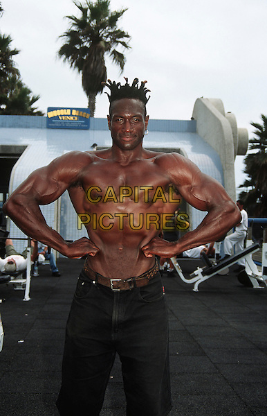 Body builder posing at Muscle Beach, Venice Beach, Venice, Los Angeles, California, USA
