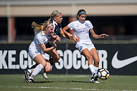 Sanford, FL - Saturday Oct. 14, 2017:  A Pride defender clears the ball away from pressure during a US Soccer Girls' Development Academy match between Orlando Pride and NC Courage at Seminole Soccer Complex. The Courage defeated the Pride 3-1.