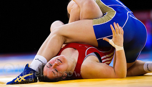 11 DEC 2011 - LONDON, GBR - Chloe Spiteri (GBR) (in red) attempts to free herself from the grip of Ekaterina Bukina (RUS) (in blue) during their 72kg category quarter final bout at the London International Wrestling Invitational and 2012 Olympic Games test event at the ExCel Exhibition Centre in London, Great Britain .(PHOTO (C) NIGEL FARROW)