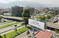 BOGOTA, COLOMBIA - March 23:  Aerial view of an almost empty street next to a billboard that reads 'on Covid-19, if you take care of your self, we all take care of ourselves'  in Bogota on March 23, 2020. Colombian government declared a nationwide quarantine from March 24 until April 13 to prevent the spread of the Coronavirus that has 306 confirmed cases in the country at the moment. (Photo by Daniel Munoz/VIEWpress via Getty Images)