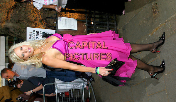 LAURA BAILEY.Glamour Magazine's Women of the Year Awards 2004,.London, 8th June 2005..full length pink purple fucshia Mattheew Williamson peony dress flower corsage black tights clutch bag.Ref: BR.www.capitalpictures.com.sales@capitalpictures.com.©Capital Pictures.