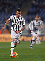 Calcio, Serie A: Lazio vs Juventus. Roma, stadio Olimpico, 4 dicembre 2015.<br /> Juventus&rsquo; Mario Mandzukic in action during the Italian Serie A football match between Lazio and Juventus at Rome's Olympic stadium, 4 December 2015.<br /> UPDATE IMAGES PRESS/Isabella Bonotto