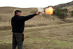 A man spends the afternoon in San Benito, Calif., shooting his old firearms, to make sure that they can still fire and have not lost their value. Photo taken on November 27, 2010