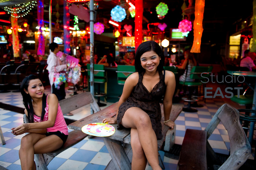 Bar hostesses wait for clients to lure into their bar, in Pattaya, Thailand, on November 12. 2010. Photo by Lucas Schifres/Pictobank