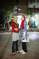 Twins Rawan and Rawda are among the youngest Muslim Sisters in the Nasr City's group. Cairo, June 2012.