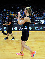 Katrina Grant carries the trophy to her teammates after the Taini Jamieson Trophy Series netball match between the New Zealand Silver Ferns and England Roses at Claudelands Arena in Hamilton, New Zealand on Wednesday, 13 September 2017. Photo: Dave Lintott / lintottphoto.co.nz