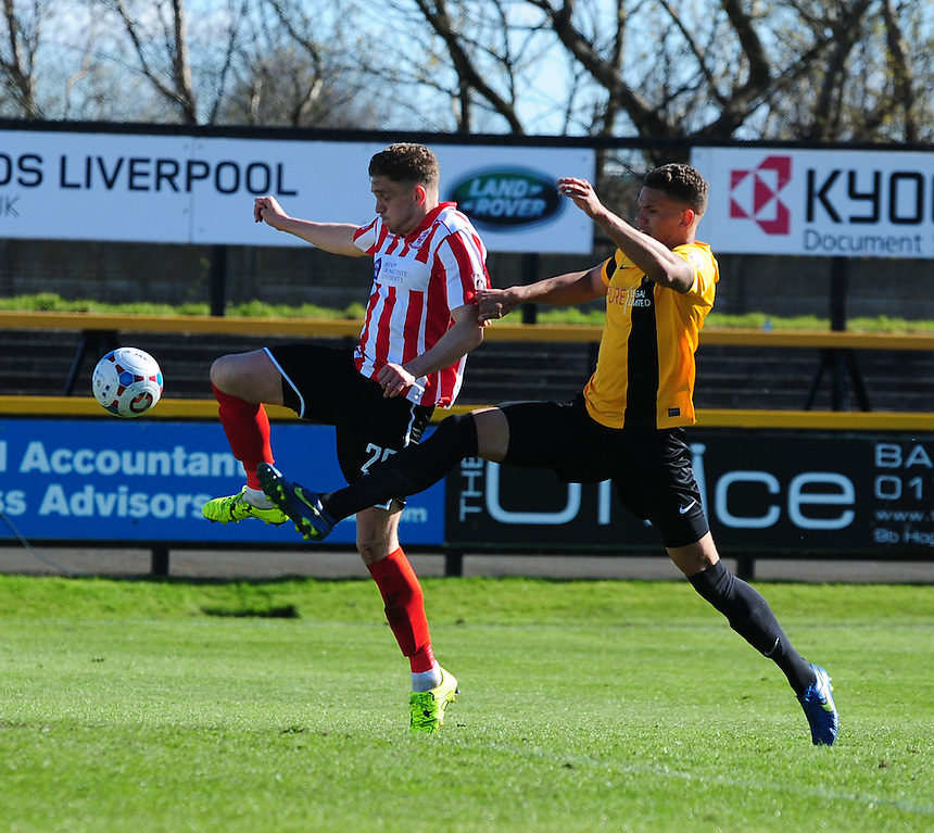 Lincoln City's Callum Howe vies for possession with Southport's Liam Nolan in the Southport goalmouth<br /> <br /> Photographer Andrew Vaughan/CameraSport<br /> <br /> Football - Vanarama National League - Southport v Lincoln City - Saturday 16th April 2016 - Merseyrail Community Stadium - Southport<br /> <br /> &copy; CameraSport - 43 Linden Ave. Countesthorpe. Leicester. England. LE8 5PG - Tel: +44 (0) 116 277 4147 - admin@camerasport.com - www.camerasport.com