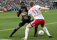 CHESTER, PA - OCTOBER 27, 2012:  Raymon Gaddis (28) of the Philadelphia Union battles with  Dax McCarty (11) of the New York Red Bulls during an MLS match at PPL Park in Chester, PA. on October 27. Red Bulls won 3-0.