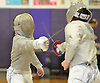 Patrick Gao of Great Neck North, left, battles Donal Mahoney of Garden City during the Nassau County boys' fencing saber final at Oyster Bay High School on Saturday, Jan. 30, 2016. Gao won 15-11 to claim the county title.