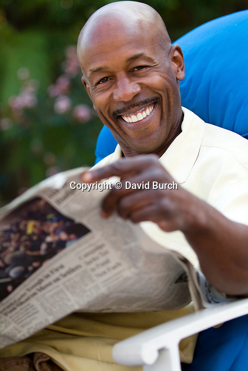 Man with newspaper, smiling, portrait