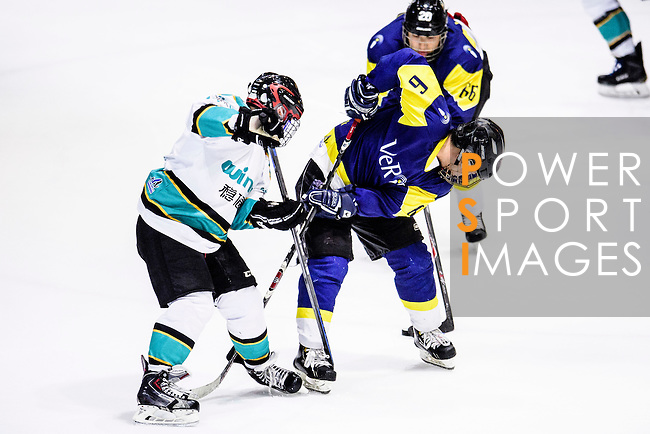 Verity Skater #6 Bernard Law (r) fights for the puck with Medical Kings Defender during the Principal Standard League match between Medical Winner Kings vs Verity at the Mega Ice on 17 January 2017 in Hong Kong, China. Photo by Marcio Rodrigo Machado / Power Sport Images