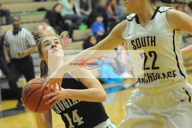 Chugiak's Eva Palmer looks for her shot against the defense of South's Isabel Babiak Feb. 18, 2017. Photo by Michael Dinneen for the Star.